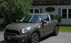 2011 MINI Cooper Countryman AWD Moca Brown with Carbon Black interior. For the great combination of handeling and rides to the ski country! There are only 25,000 miles on this MINI Countryman. A listing of some of the many great options are: Automatic