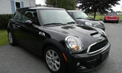 2011 MINI Cooper S Midnight Black with Carbon Black Interior. Six Speed Manual Transmission with only 45,000.00 miles. A short list of the many options are Carbon Black Sport Seats, Dual Panoramic Sun Roof, Cold Weather Pkg, Heated Seats and Heated