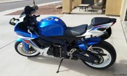 2011 SUZUKI GSX-R 600 L1 METALLIC BLUE/PEARL WHITE. 1 OWNER/(Garage Kept) Included: Yosh R77d exaust, Yosh LED fender eliminator,PAZZO white shorty lvrs,EVOTECH frame sliders,spools,bar ends,accents,and blue oil cover. Custom Metallic Blue rear hugger and