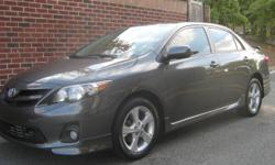 Beautiful 2011 Toyota Corolla S, 31,000 miles, Metallic Gray on black cloth sport seats, Alloy Wheels, Rear Trunk Spoiler, Sunroof, Fog Lights, Books and two keys, AM/FM/CD/Blutooth HF Radio, non-smoker unit that still smells new...!!! Great overall