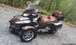 This show room condition Limited bike has all the bells and whistles. No scratches or blemishes and kept in a climate controlled garage. Never driven in the rain. this has the luggage set with GPS and its a semi auto. don't miss out on this unique color