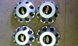 wheel center caps fits 1 ton dually asking $100.00 call or text 573-718-2126