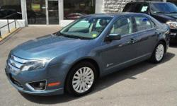 2012 FORD FUSION HYBRID SEDAN!! Rear View Camera; Full Power; 'Sony' Sound; AM/FM/CD; Air Conditioning; Dual Climate Control; Sync; Sirius; All-Weather Floor Mats; 17 Alloy Wheels; Blind Spot Monitoring System; and Keyless Entry!! All of our inventory is