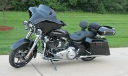 """103 V Twin Touring  black exterior  6 speed transmission  ABS  cruise  Security system  CVO genuine Harley agitator 19"""" front and 18""""rear wheels"""