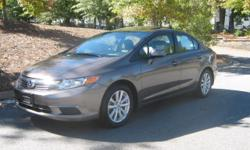 Great buy on a 2012 Honda Civic EX-L...!!! 39,000 miles, Bronze Metallic Clearcoat on Beige Leather Heated seats, Power Sunroof, Alloy Wheels on new tires, AM/FM/CD/Blutooth HF Radio, Tilt/Tele leather wrapped steering wheel. Non-smoker car,