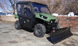 2012 Kawasaki Teryx 4 750 EFI 4x4, 4 stroke, V-Twin liquid cooled, 4 seats, fully automatic trans. This machine is in amazing condition. It only has 466 original miles and 97.8 hours of run time. This machine is excellent all the way around. The engine is