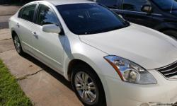 This is a white 2012 Nissan Altima, one owner, still under warranty. 90k miles. New tires and brakes.