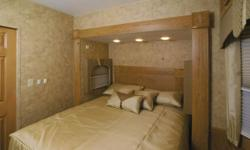 You are looking at 40 ft. travel trailer. This trailer is like brand new Only lived in for a month. It is 2 bedrooms one bathroom.Front bedroom has a queen bed and the back froom has a bunk bed both rooms equiped with mirrored Slide glass wordrobes and