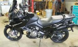 2012 suzuki v-strom 1000 adventure with factory hard bags , also has fork brace , tank bra , exhaust covers and windshield blacked out , nice clean low miles 4400. bike is like new no scratches ,scuffs , or marks.$6000. best offer call or text at