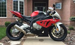 2013 BMW S1000 RR low miles and no marks on the bike. Stored in garage with cover on. It's a great bike. Bike has the premium package with heated grips and DTC with four modes, ABS I also added the Yoshimura fender eliminator kit.
