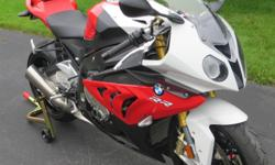 2013 BMW S1000RR. The bike looks like brand new, not a scratch on it. 1015 miles on it. Adult owned. The bike has the full electronic package - quick shifter, ABS, traction control and heated grips. This bike is by far best Super Bike I have ever ridden.