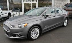 2013 Ford Fusion Energi 'Titanium' Hybrid Sedan!! Navigation; Moonroof; Blind Spot Monitoring System; Rear View Camera; Heated Seats; Remote Starter; Rear Spoiler; 17 Alloy Wheels; Full Power; Push-Button Engine Start/Stop; 'Sony' Sound; Dual Climate