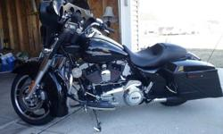 2013 Harley Davidson Street Glide FLHX has cruise control, bag extensions, LED lights under it multi color, has both rider and passenger backrest, sundowner seat, some extra chrome, has screaming eagle air cleaner with open exhaust, a power commander 5