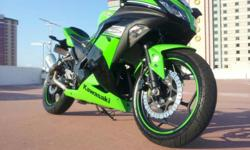 2013 Kawasaki Ninja 300 Sport Special Edition. This is a lightweight,yet powerful bike. It has lots of add-ons. It has a Juicebox super tuner, two-brothers exhaust,color-changing neons,custom tail light with built in blinkers, tank and skid protectors.