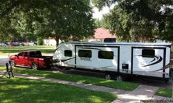 Camper is a 29 footer with 2 Slide outs and an Outdoor kitchen. Sleeps 11 people and is in excellent condition. We have only used about 10 times.