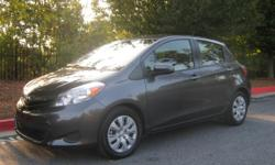 2013 Toyota Yaris LE Hatchback Sedan, Beautiful Metallic Gray on light gray and black cloth seats. 41,800 miles, 1.5L 4cyl motor, Great gas mileage and highway cruiser. Comes equipped with Cruise, Power Windows, Power Brakes, Power Steering,