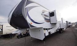 The 2014 Heartland Bighorn 3875FB is a fifth wheel that comes with a front bathroom and three large slides. This particular RV comes with the King of the Mountain Package that includes numerous options. The rear of this trailer has a large sofa ?that