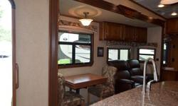 Beautiful Fifth Wheel, with four slides, many great features, and sleeps four!!! Great for family outings!!! Call for price.