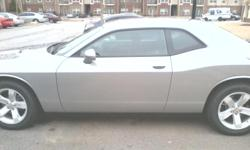Looks New Drives New! Sterling Silver 2014 Dodge Challenger! This beauty comes ezuipped with a V6 cylinder engine and has less than 10,000 miles on it. It also contains perfect condition grey cloth seats, am/fm stereo, CD player, MP3 player, satellite