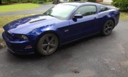 Get ready to feed your need for speed with this 2014 Ford Mustang GT! This two-door pony car features a handsome and sporty styling that has become an icon of the American automobile industry. It comes dressed to impress with Deep Impact Blue