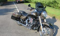 JUST LIKE NEW--ONLY 1,805 MILES! For the rider who wants it all, the bike that has it all: classic style, long haul comfort. Heavy custom details. Totally re-thought to give you more of that big road-eating grin. The 2014 Harley-Davidson® CVO? Road King®