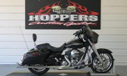 The 2014 Harley-Davidson® Street Glide® model FLHX is a custom hot-rod bagger with an amazing Harley® style that needs to be seen and ridden. As part of Project RUSHMORE, it's been totally redesigned for 2014 from headlight to taillight to make the look