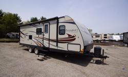 The 2014 Keystone Passport Grand Touring 2510RB is a travel trailer that has a single large slide, a rear bathroom and a Parsley interior décor. The private rear bath has a shower, sink and toilet. Wardrobe storage is also contained in the rear of this