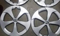 I have four hubcaps from my 2014 Toyota Prius Hybrid. I don't have any use for them. Two of them are in like new condition. The other two have scratches on them but they are repairable.