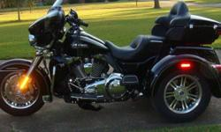 Beautiful HD FLHTCUTG Tri-Glide, Garage kept, perfect condition, under warranty until 11/19. Many many extras. Bought new one owner. 850-968-9912 or 206-6734.