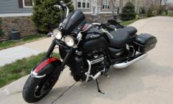2014 Triumph Rocket Roadster ABS. I have added many extras onto the bike. These are:  Crash bars with highway pegs  Color matched flyscreen  Tank pad  Smoked indicator lenses