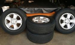 18 inch rims , alloy . Tires Bridgestone Dueller H/T P275 . Brand new less than 5000 miles .