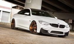 This 2015 BMW M4 is a beautiful Alpine White with 13K miles. It is equipped with every option except Carbon Ceramics. The seller is asking $69K which doesn't include the $20K worth of aftermarket upgrades. This BMW is OEM Alpine and has been fully wrapped