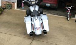 """I've added a cvo chopped tour pack with the chrome harley locks, tour pack organizer, 4.50"""" vance and hines slip ons, paul yaffe 12"""" apes with tribal mirrors, passenger floorboards and highway pegs. Contact me with any questions, can provide"""