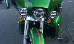 2015 Harley Davidson Ultra Classic Low FLHTKL Radioactive Green Limited color It has a Twin Cam 1,600, 90cc (103) engine with a 6 speed Transmission. Comes with one helmet headset, owners manual, and two keys. Serious offers only. Please ask if you