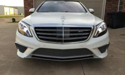 Get ready to to indulge with this 2015 Mercedes-Benz S65 AMG!  This four door luxury car features a sleek and smooth styling that comes dressed to impress with the rare and expensive paint option of Designo Magno Cashmere White (Matte Finish).