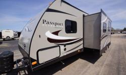 The 2015 Keystone Passport Grand Touring 2770RB is a double slide travel trailer that comes with a bathroom in the rear. This RV comes with a Parsley interior décor. The private bathroom in the rear includes a shower with a glass door, sink and toilet.