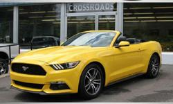 2015 FORD MUSTANG CONVERTIBLE! Glowing Yellow Paint! Premium Eco Boost! SHAKER Sound! Heated AND Cooled Leather Seats! Power Black Convertible Top! Alloy wheels with Like NEW tires! Spotless inside and out! Must be seen and driven! All of our inventory is
