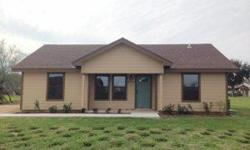 This beautiful newly constructed 1,030 square foot 3 bedroom 2 bath home is located on a large country lot just North of Harlingen in Combes Tx. You will love the floor plan, front porch, custom cabinets and city water & city sewer. This home