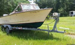 boat trailer still has wood boat with 140hp chrysler on it. trailer good cond. electric winch