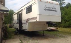 1994 all redone to perfect condition. In perfect running condition. Great for those just starting to camp or for a warm cozy clean place to sleep for all deer hunters. Must see to believe how nice. One slide out. Two recliners with table and chairs and