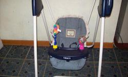 TWO GRACO INFANT SWINGS--ONE IS NAVY BLUE WITH BEIGE PLAID--2 SPEED, MUSIC, , and 2 play toys attached--$20 Clean, Good Condition. The other is Olive Green with beige plaid--6-speed with music, timer, no toys attached, but clean and good condition. $20