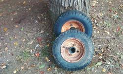 2 trailer tires w ith rims 4 lugs.8 inches tall