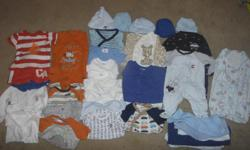 39 pieces of never/gently used 0-3 month boys clothing. Smoke and pet free home. Includes: 6 pants 9 onsies 2 PJ footie sleepers 2 PJ footless sleepers 1 long sleeved romper with bottom open 4 pant rompers 2 shorts + 1 short sleeved shirt that matches one