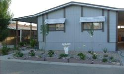 3/2 Mobile Home in a Family Park Will do a rent to own Also, will trade for something of similar value such as an RV, Truck, or??  Park has two pools There is a basketball court, tennis court, park, pool tables, club house, meeting