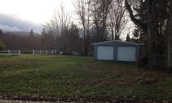 BUILDABLE LOT FOR SALE IN PORT ANGELES, WASHINGTON  3/4 ACRE PROPERTY backed up by a ravine with a creek at the bottom. It has a 24 X 24 SHOP/GARAGE on the property. There are several trees on the property and several in the ravine. This lot would