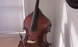 Christopher 3/4 Scale Upright Bass  2002, Model DB603T Solid spruce top and solid maple back and sides. Neck, including the scroll are made of solid maple as well. The manufacturer noted that woods for 600 series basses are specifically,
