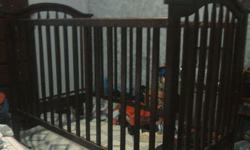 3 in 1 dark brown crib. Its in great conditions but has some bite chips. I'm asking 65 or best offer, need it gone. Crib, daybed, and toddler bed. Questions txt --