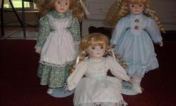 I have three very cute Porcelain Dolls, in very good condition, up for sale. Two of them come with stands their stands included. These are from the Heritage Mint Collection and are being sold as a set! Again, all dolls are in very good condition with all