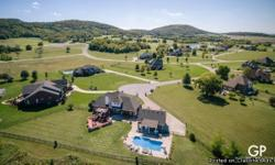 Golf community home! Kitchen updated with granite, new Kenmore Elite micro-convection oven , Media room has wet bar & fully wired for sound. Large custom pool with spa waterfall combo. Three heated and cooled garages. Cover patio and bath for pool. See