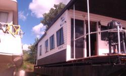 2 bedroom 40foot custom built houseboat 2 decks Big front room, bathroom ,kitchen,all teak wood inside 2steel floots 1 Aluminium114 V4 johnson,new front deck all new siding asking 20k ao best offer Thank Jeff 651-503-7410